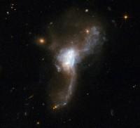 ESO 148-IG002, AM 2312-591