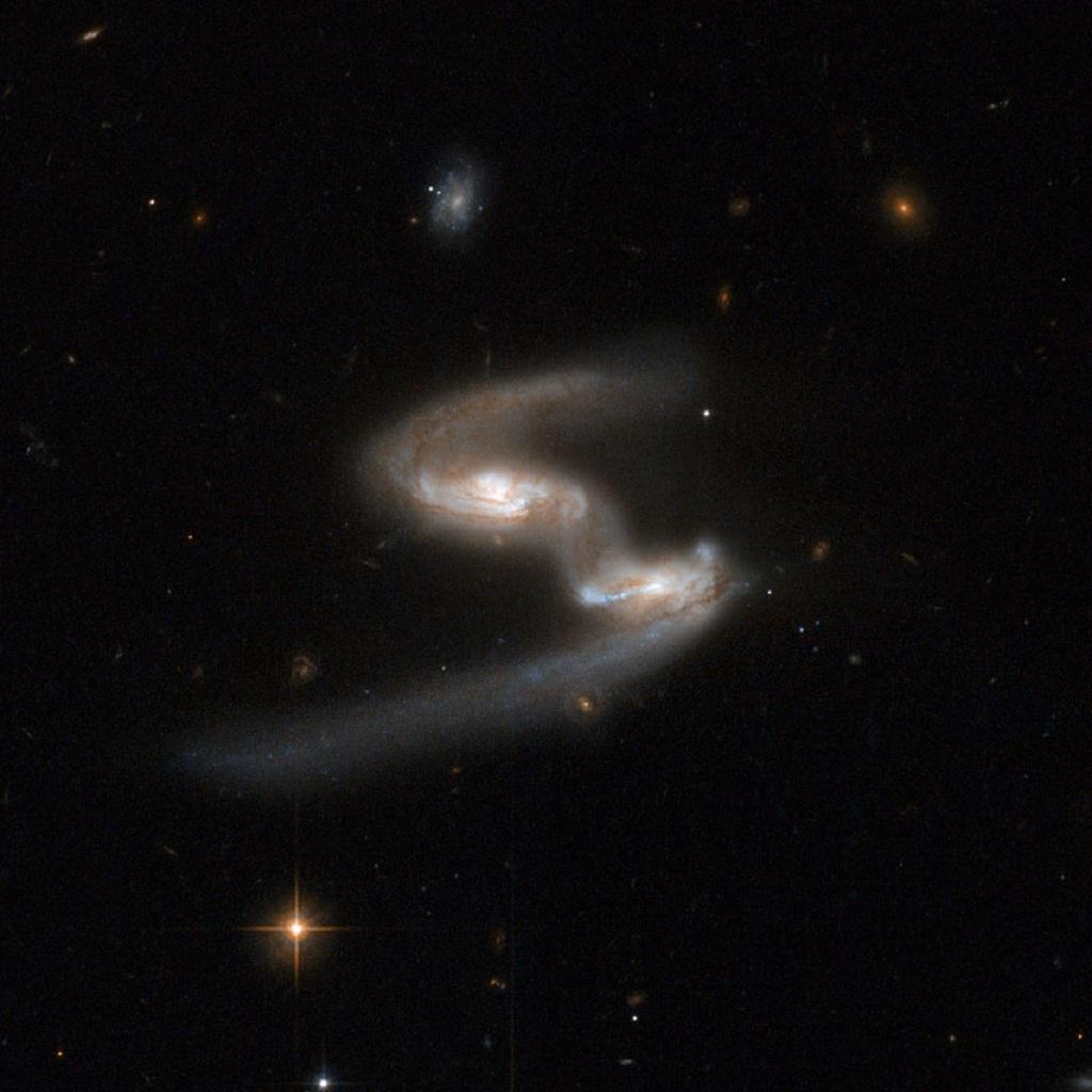 ESO 77-14, a dancing pair of interacting galaxies