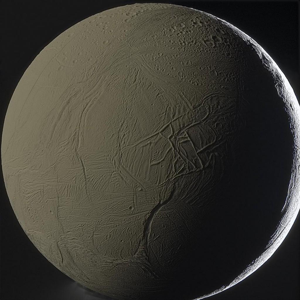 Enceladus backlit by Saturn