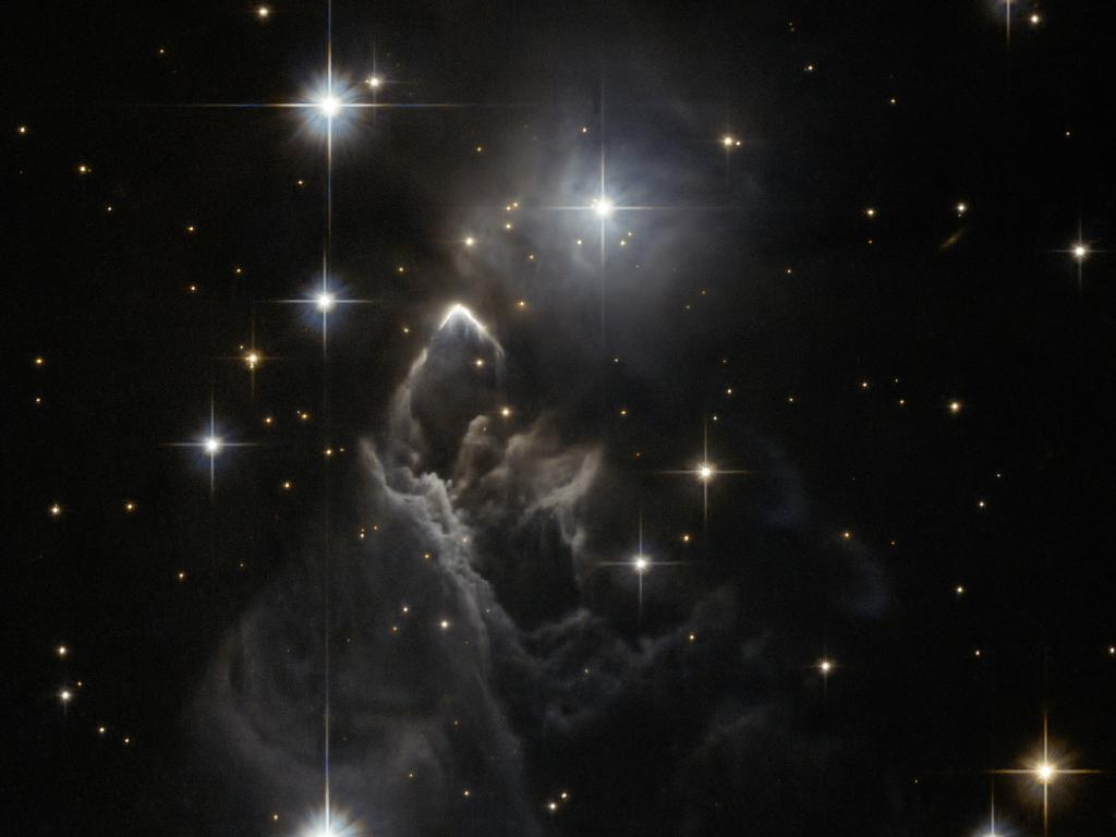 IRAS 05437 2502 A Mysterious Reflection Nebula And Star Forming Region