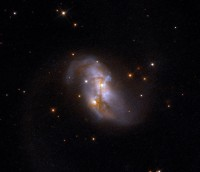 IRAS 23436+5257, a distorted galaxy in Cassiopeia