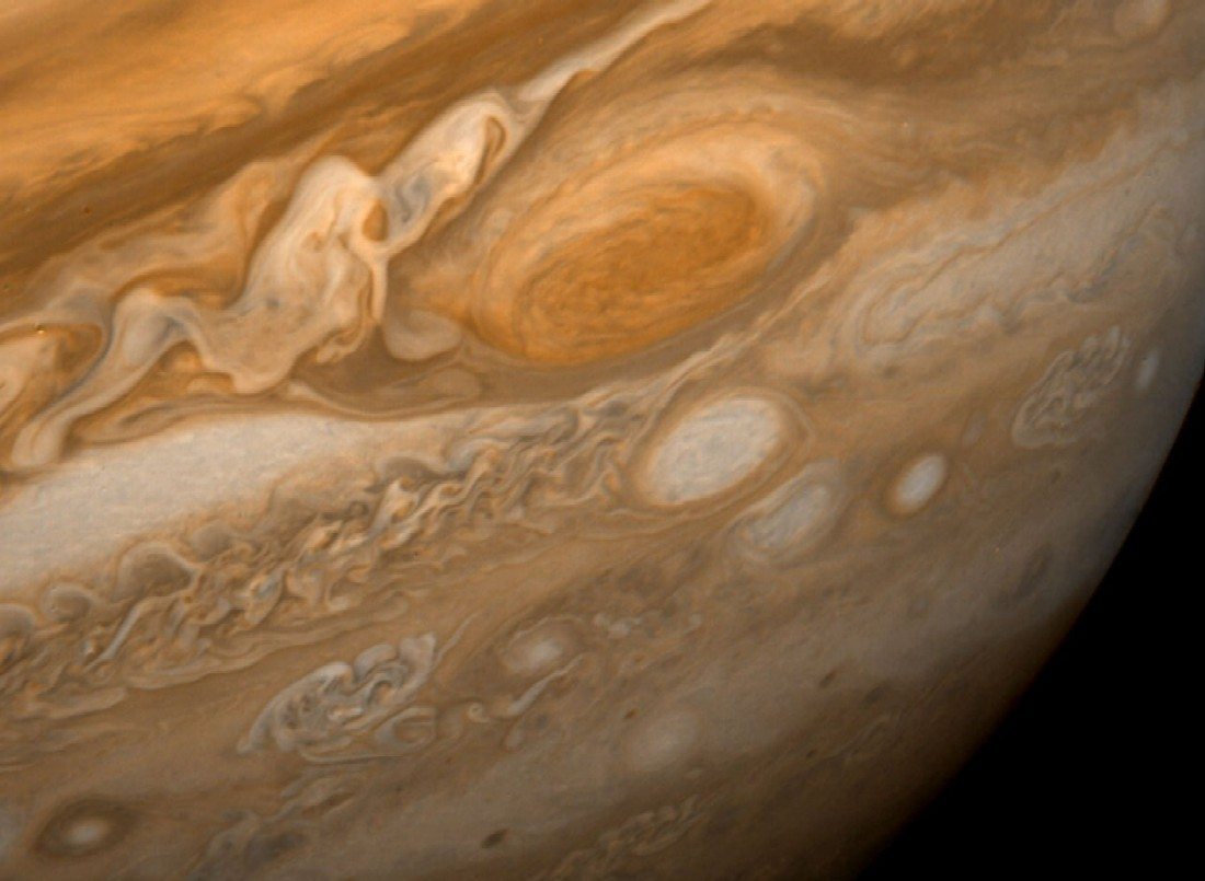 Jupiter's Great Red Spot is an anti-cyclonic (high- pressure) storm where the Earth could fit in. Clouds swirl around the spot (going counter-clockwise) at varying altitudes