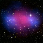 MACS J0025.4-1222 is a galaxy cluster created by the collision of two galaxy clusters in Cetus. The separation between the normal matter (pink) and dark matter (blue) therefore provides direct evidence for dark matter