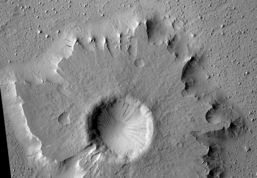 Mars' Pedestal crater and streaks in southwest Amazonis. The location is 7.3 degrees north latitude and 164.6 degrees west longitude. Image was taken with HiRISE