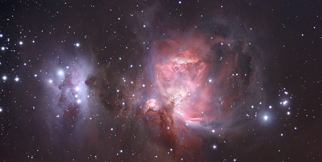 Messier 42, the Orion Nebula (right), a diffuse reflection and emission nebula, and NGC 1977, the Running Man Nebula (left), an open star cluster embedded in several emission nebulae and  a reflection nebula