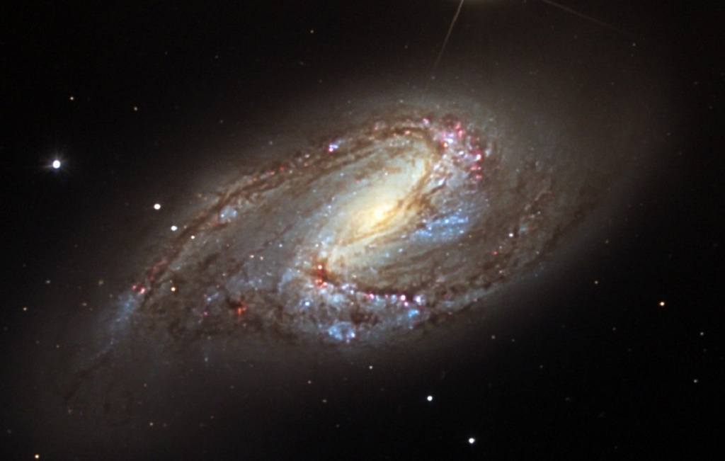 Messier 66, an asymmetric spiral galaxy