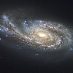 NGC 908 is a barred starburst spiral galaxy, 65 million light-years towards Cetus. It is 75 000 ly long and presents uneven and thick spiral arms, indicating that it suffered a close encounter with another galaxy