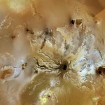 Ra Patera, a large shield volcano on Jupiter's moon Io, shows colorful flows up to about 200 miles long emanating from the dark central volcanic vent