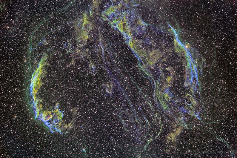 The Veil Nebula is a cloud of heated and ionized gas and dust 1470 ly away in Cygnus. It is part of the Cygnus Loop, a large but relatively faint supernova remnant that exploded some 5,000 to 8,000 years ago
