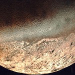 Triton's bright south polar cap above a region of cantaloupe terrain