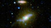 Cosmic 'Leaf Blower' Robs Galaxy of Star-Making Fuel