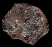 Team finds asteroids were bombarded by iron loving elements too